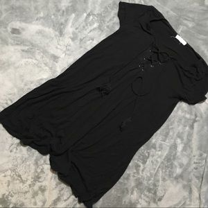 Black Swing dress with laced up neckline.